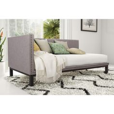 Simple and sophisticated, the Mid-century Upholstered Daybed from Avenue Greene brings the late 18th century classic style to life. with its streamlined silhouette, soft linen fabric and nail head trim, the daybed's refined profile suits any decor style.