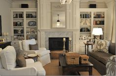 """layout possibility...  highlighting a focal wall, flat screen off to the side with console underneath (more storage/media).  The function of this room is comfy and kinda """"living room"""" formal also.  Love the way this was handled."""