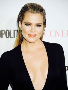 Khloé Kardashian pairs her slicked back hair with peachy lips and bronzed cheeks