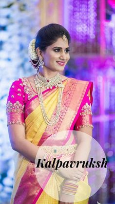 What a beautiful large low bun with real flower gajra and ornamental hair chains! Care however should be taken before adopting such hairstyles, as due to it's high static charge, it will cause phlegm to move up in the throat, causing the voice to quaver & a frequent urge to clear the throat. A heavy chabi chhalla with a long & wide hook if inserted at the edge of the pleats of the saree, will reduce this problem as it's hook will activate the acupressure points that act to keep the throat…
