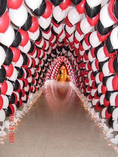 Prom entrance- balloon tunnel.  Over 3000 balloons and 150' of tunnel, accented with lights at the bottom.