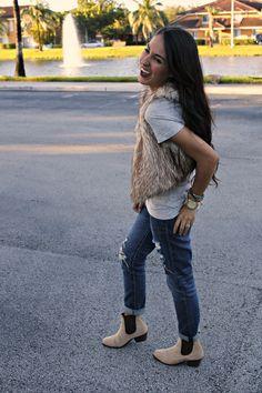 fur vest and boyfriend jeans... Love it all minus the shoes