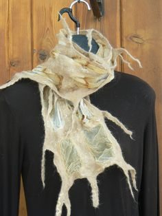 The piece entitle Gentle Geometric uses fine silk chiffon wrapped around rusty farm implements using vinegar, water and air exposure to enhance the oxidation process. Alpaca (Creemore's fibre only) was laid across the silk and rolled in to alpaca 'fingers'. Silk Chiffon, Vinegar, Fingers, Scarves, Water, Scarfs, Water Water, Tie Head Scarves, Aqua
