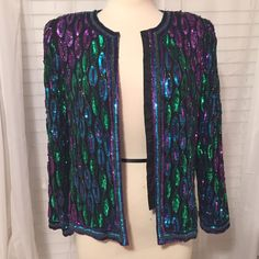 Vintage Blazer Stunning vintage jacket/blazer with hidden clasps to dress it open or closed. In beautiful condition. It says PS but it fits a medium. Outer is sequins on silk and interior is polyester. Vintage Jackets & Coats Blazers