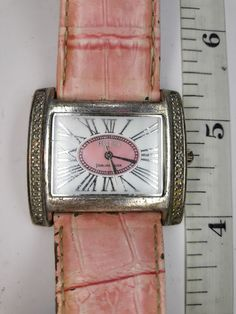 New battery. Keeps excellent time. Watch is made of Sterling silver. White face with pink center and silver Roman numerals. This is a very Nice looking Watch. Band is a little worn. Vintage Watches Women, Square Watch, Pink Leather, Band, Sterling Silver, Accessories, Sash, Bands, Jewelry Accessories