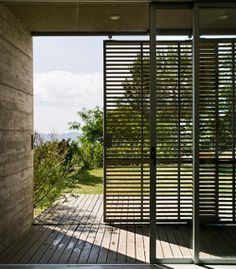 Sliding Exterior Door with sliding shutters...modern low country awnings
