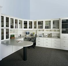Prestige office in an Antique White finish Melamine with 90o peninsula, Deco doors with smoked glass inserts, Deco drawers, office accessory inserts, stainless steel handles, top and bottom molding.