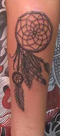ROUGH IDEA OF EXAMPLE...   With this tattoo being low on the my side of both, hip and upper thigh ( 1-2 inches below the pant/bikini 'hip' line) the idea arose to possible shift the feathers. I'm stuck with this idea because other/ more linear dreamcatchers are visibly more appealing but the movement could look good there?