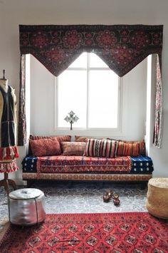 Uzbek textile, Berber pillows, Ethiopian cross. Marrakesh by Design Morrocan Homes. Maryam Montague - mediterranean - living room - new york - Workman Publishing/Artisan Books
