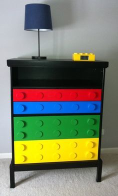 And this was my favorite piece! I got this old dresser at IKEA about 13 years ago, and repainted it in black, and the drawers I just painted in primary colors, then I glued wooden discs all over the drawers to give it a LEGO look, the result was better than I first imagined it. I just love it and is was so easy and fun!!!