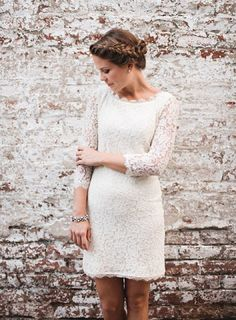 This short white lace wedding dress of vintage style is characterized with exquisitely scalloped boat neckline, modest illusion lace sleeves, body-hugging silhouette of sheath, and convenient length of above-knee. Short Ivory Wedding Dress, Colored Wedding Dresses, Wedding Gowns, Wedding White, Vintage Lace Weddings, White Lace Shorts, Marie, Lace Dress, Dresses With Sleeves