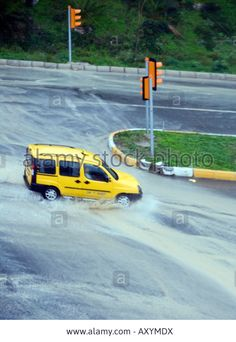 Yellow taxi at intersection traffic-lights Torrential rain Kusadasi, Turkey, Eurasia, Asia Minorhttps:/ https://www.youtube.com/watch?v=jdNjqN_7tXs