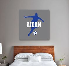 Our personalized soccer canvas will look great in your bedroom or dorm room.  You can customize it with any of the colors from our palette or order it in the grey, royal blue and white color combo shown. This custom wall art is the perfect bedroom decor for any boy or teen soccer player! Sports themed Christmas present or birthday gift.