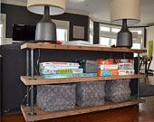Industrial Reclaimed Wood Console Table 4' Long (3 shelves). $699.00, via Etsy.
