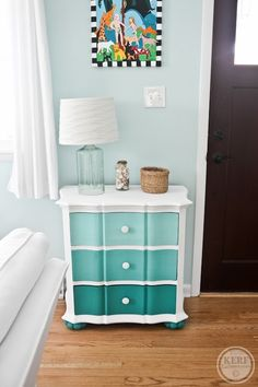 """I used Annie Sloan Chalk Paint (we have a new store here in Cville) and didn't even have to sand it! I mixed the ombre colors myself with the teal and white getting lighter as I added more white. Note also the Target seaglass lamp and grassy basket for keys."" via Kath Eats Real Food"