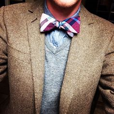I really like this because normally a prominent bow tie will stand out and seem too bold for a lot of outfits that aren't the utmost formal but this, this is different. It's conservative and more casual look with a brighter bow tie yet offsets the duller colors and looks great.