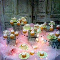 tulle with clear strands of lights added creates a lavish surface for displaying cupcakes see more bridal shower decorations and