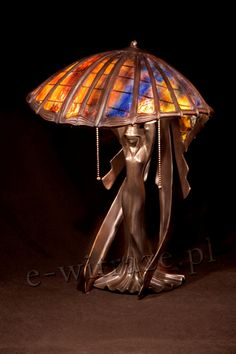 Wieniawa Piasecki Nymph lamp, inspired by L.C. Tiffany #tiffany #lamp www.e-witraze.pl #manmade #stainedglass #handcrafted #unique #metalware #louis #comfort #glass #nymph #woman #umbrella #leaf #tablelamp www.e-witraze.pl #poland #design #art #light