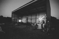 Barn wedding lit up with fairy lights.  nik & chris | an eco-friendly, handmade coastal welsh wedding - Pete Cranston