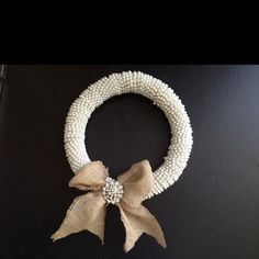 Pearl wreath with a burlap bow & I just had to add the brooch (: