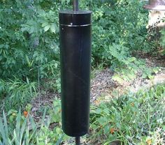 How to Make a Squirrel and Raccoon Bird Feeder Baffle | Today's Homeowner