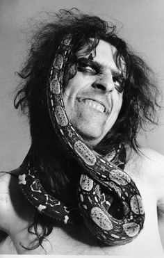 Alice Cooper with snake Fact:: alice cooper once had to get his snake cut off of him because it started to strangle him