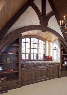 Window nook with beautiful wooden beam archway.