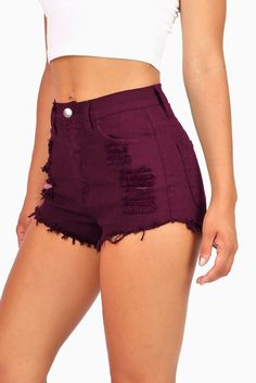 "High waisted color denim shorts with distressing on the front with fraying edges. Traditional 5 pockets zip fly and button closure. Runs small. *Machine Wash Cold*98% Cotton 2% Spandex*11""/28 cm Top to Bottom 1.75""/5cm Inseam - Measured on a size M (Model"