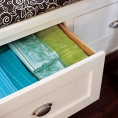 These spacious drawers store linens in a built-in banquette