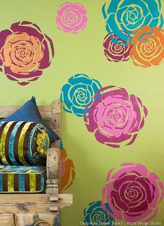 How to layer rose stencils to create a colorful wall finish on Paint + Pattern using Royal Design Studio wall art stencils