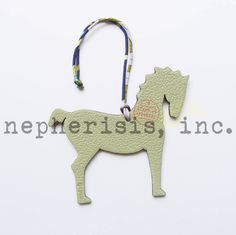 Hermes petit h leather ornament in horse design. New condition with Hermes box and ribbon.