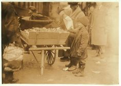Selling oranges at market. Location: Boston, Massachusetts January 27, 1917 photo by Lewis W. Hine