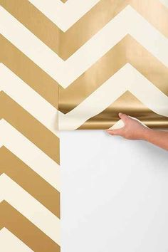 vinyl-coated, self-adhesive decorative wallpaper in a two-tone gold chevron from. vinyl-coated, self-adhesive decorative wallpaper in a two-tone gold chevron from Urban Outfitters. Gold Chevron Wallpaper, Chevron Walls, Herringbone Wallpaper, Metallic Wallpaper, Home Design, Design Hotel, Home Decor Inspiration, Design Inspiration, Decor Ideas