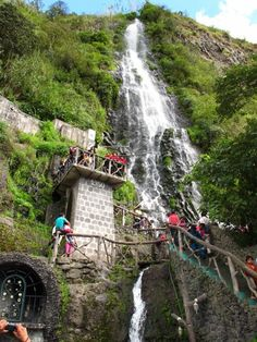 Baños, Ecuador — by Esther Bichachi. Locals and tourists climb the steep staircase to bathe, photograph, and/or admire this wonderous waterfall. #waterlust
