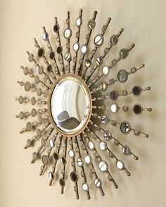 """""""Kimani Starburst"""" Mirror at Horchow.  This would look really cool in dining room."""