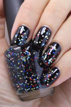 "From grape fizz nails. ""First up is Who Are You Calling Bossy!?! inspired by Lucy's raven hair.  This gorgeous black cream is a one coater!"" Glitter: ""To Be Or Not To Beagle which is inspired by Snoopy's happy dance of colors. This is a super fun glitter topper that has lots of black mini glitter and black mini bar glitters with larger hex glitters in red, peach, yellow, white and blue."""