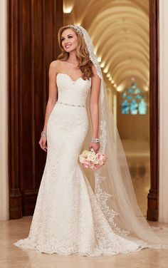Lace and more lace. This romantic lace over rich dolce satin slim A-line bridal gown from Stella York features scalloped trim on its sweetheart bodice, hem, and chapel train.