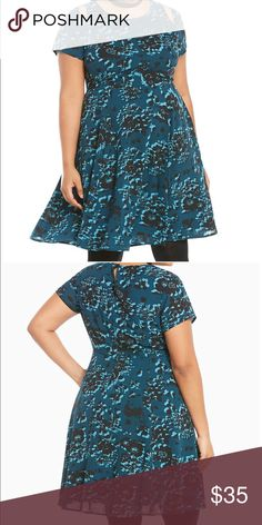 NWT torrid size 24 floral skater dress w/ cutouts NWT torrid size 24 floral skater dress w/ cutout . The teal georgette is fully lined and fully floral with a black and light blue pattern. While the silhouette is slightly retro with a crew neck bodice and a fit-and-flare skirt, the cutouts along the shoulders take it to the new age. torrid Dresses