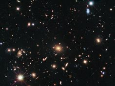 ESA Science & Technology: Hubble astronomers check the prescription of a cosmic lens - First ever gravitationally lensed Type Ia supernovae discovered [heic1409]