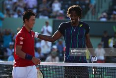 Kei Nishikori of Japan shakes hands at the net after his three set victory…