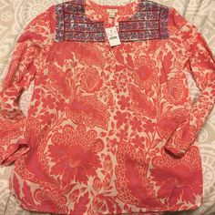 NWT J.Crew pink and white blouse with embroidery NWT J.Crew pink and white blouse with Carolina blue and navy embroidery at the top. Blouse has three quarter length sleeves with buttons at the bottom of sleeve so you can roll them up. Mother of Pearl buttons on sleeve and half way down the front of the blouse. Embroidery is only on the front. Size small but fits like a medium. J. Crew Tops Blouses