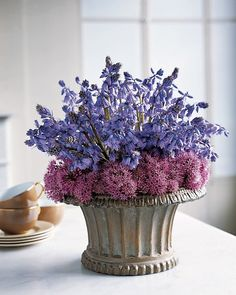 Purple Pairings: Spanish Bluebells and Blossoming Chive  Mingle dainty Spanish bluebells with fluffy chive blossoms for a textured centerpiece.