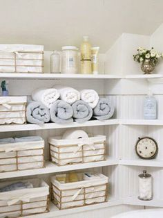 Linen closet Inspiration  #Couturestagingtips : Baskets are a great way to hide toiletries and eliminate clutter lingering around your bathroom & rolling the towels will make you feel like your at a spa.. Ahh ...Feeling more relaxed already !!  @Erin Davison Home Couture