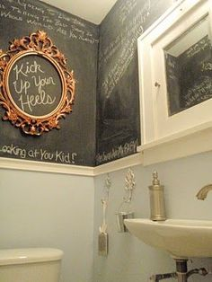 bathroom graffiti, guest bath. My cousins have a bathroom like this, but the walls are corkboard and you can pin notes, pictures, etc. to the wall. It's been there for years so it's like a time capsule.