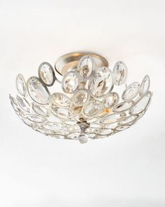 Flush-mount ceiling fixture made of steel and crystal. Mounts flush with the ceiling with little or no space between the fixture and the ceiling itself. Distressed finish. Uses three 60-watt bulbs. Di