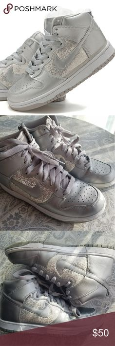 Women's Nike DUNK silver and grey sequin high tops Women's Nike Dunk high tops, size 7.5.  These silver and grey high tops are very cute and sparkle in the sunshine!  Bonus? With neutral shades of grey and silver, they'll match almost anything!  Used but still in very good condition - some sequins are missing but it isn't noticeable when the shoes are worn. The body and soles are both in excellent condition. Nike Shoes Sneakers