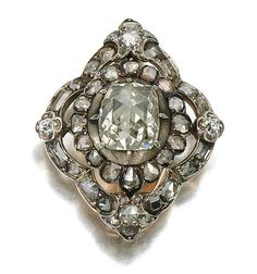 DIAMOND BROOCH/ PENDANT, EARLY 19TH CENTURY.  Of lozenge design, set with cushion-shaped, table-cut and rose diamonds, hinged pendant bail, detachable brooch fitting.