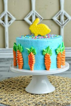 Haniela's: Easter Cake Decorated with Buttercream Carrots and Pretty Bunny Cookie Topper