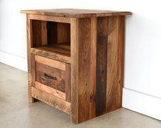 Warm up your bedroom with our rustic looking reclaimed wood nightstand made from old growth oak, maple, and pine for your bedroom. This nightstand features 1 - 8 inch drawer and an open shelf to displ Reclaimed Wood Nightstand, Wood Dresser, Reclaimed Barn Wood, Old Wood, Pine Nightstand, Wood Chest, Bedside Tables, Nightstands, Pallet Furniture