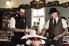 Tattooed barbers. Love this.